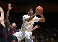 Tyrone Wallace of California passes the ball during the game against Stanford at Haas Pavilion in Berkeley, California on February 5th, 2014.  Stanford defeated California, 80-69.