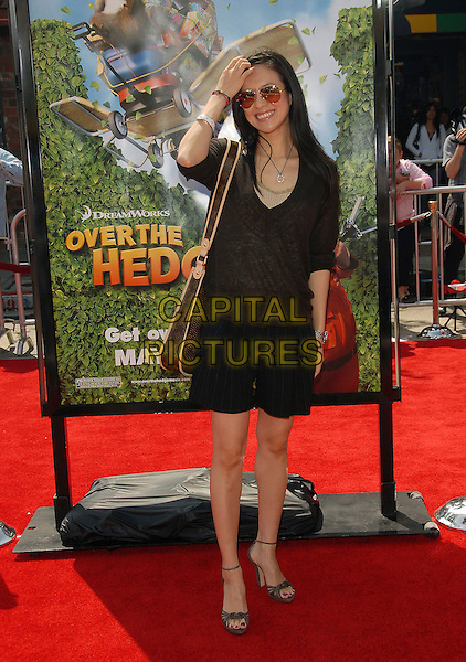 "ZIYI ZHANG.Red Carpet arrivals at The DreamWorks's Los Angeles Premiere of ""Over the Hedge"" held at The Mann Village Theatre in Westwood, California, USA,.April 30th 2006..full length sunglasses aviators shorts black top Louis Vuitton bag hand on touching hair head.Ref: DVS.www.capitalpictures.com.sales@capitalpictures.com.©Debbie VanStory/Capital Pictures"
