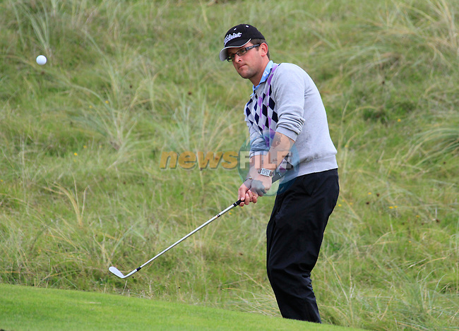 Glen Robinson chips onto the 18th green during Day 3 of the 100th Irish PGA championship at Seapoint Golf Club, Co Louth...Picture Eoin Clarke/www.golffile.ie.