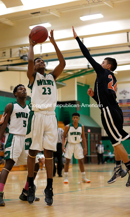 Waterbury, CT- 07 January 2016-010716CM05- Wilby's Ahmad Alves shoots the ball against against  Watertown's Tom Labbe during their NVL matchup in Waterbury on Thursday.     Christopher Massa Republican-American
