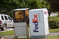 A UPS and FedEx Express mailboxes are pictured in Augusta, Maine Tuesday June 18, 2013.