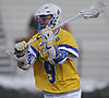 Bryce Tomlie #9 of Hofstra University carries behind the net during an NCAA men's lacrosse game against Monmouth at Shuart Stadium in Hempstead, NY on Wednesday, March 14, 2018. He broke a 6-6 tie with a goal with 1:37 remaining in the fourth quarter to lead Hofstra to a 7-6 win.