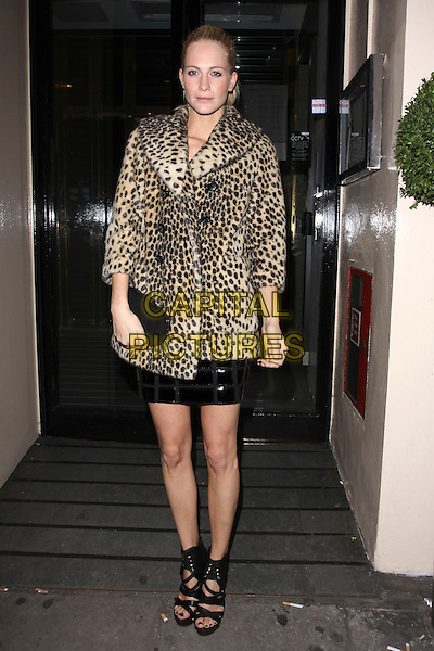 POPPY DELEVIGNE .Attending the Launch of Lulu & Co at Harvey Nichols, Knightsbridge, London, England, UK, October 21st, 2010..full length leopard print fur coat black dress open toe platform sandals clutch bag strappy .CAP/AH.©Adam Houghton/Capital Pictures.