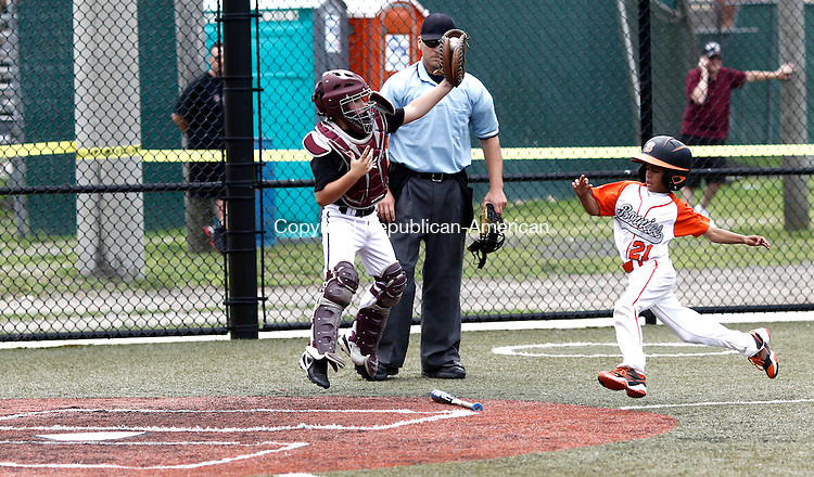 Waterbury, CT- 10 July 2014-071014CM05-  Overlook's Mikey Deitelbaum leaps up for the ball as Bonnie's (Brooklyn, NY) Jordan Ynoa scores a run during the opening round of the Roberto Clemente (7-8 year-old) North Atlantic Regional baseball tournament in Waterbury on Thursday.    Christopher Massa Republican-American