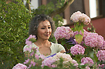 Asian woman working in her garden