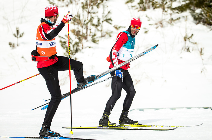 PyeongChang 9/3/2018 - Brian McKeever, of Canmore, AB, and guide Russell Kennedy, of Canmore, AB, during a biathlon/cross country training session at the Alpensia Biathlon Centre during the 2018 Winter Paralympic Games in Pyeongchang, Korea. Photo: Dave Holland/Canadian Paralympic Committee