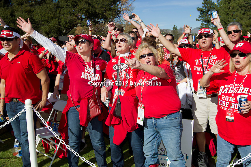 "Wisconsin Badgers fans sing ""Varsity"" at the Badger Tailgate Party prior to the 2012 Rose Bowl NCAA football game against the Oregon Ducks in Pasadena, California on January 2, 2012. The Ducks won 45-38. (Photo by David Stluka)"