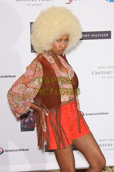 NATALIE COLE<br /> 13th Annual Race to Erase MS - Arrivals held at the Hyatt Regency Century Plaza Hotel, Century City, California,<br /> USA, 12th May 2006.<br /> half length blonde afro wig seventies costume <br /> Ref: ADM/ZL<br /> www.capitalpictures.com<br /> sales@capitalpictures.com<br /> &copy;Zach Lipp/AdMedia/Capital Pictures