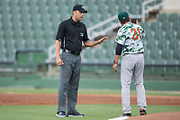 Augusta GreenJackets manager Carlos Valderrama (21) argues a call with base umpire Emil Jimenez during the game against the Kannapolis Intimidators at Kannapolis Intimidators Stadium on May 3, 2017 in Kannapolis, North Carolina.  The Intimidators defeated the GreenJackets 7-4.  (Brian Westerholt/Four Seam Images)