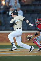Shane Muntz (11) of the Wake Forest Demon Deacons follows through on his swing against the Gardner-Webb Runnin' Bulldogs at David F. Couch Ballpark on February 18, 2018 in  Winston-Salem, North Carolina. The Demon Deacons defeated the Runnin' Bulldogs 8-4 in game one of a double-header.  (Brian Westerholt/Four Seam Images)