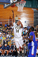 12 November 2010:  FIU's DeJuan Wright (14) lays up the ball for a basket in the second half as the FIU Golden Panthers defeated the Florida Memorial Lions, 89-73, at the U.S. Century Bank Arena in Miami, Florida.