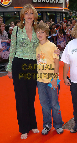 "SHARON MAUGHAN & SON.""Herbie: Fully Loaded"" UK Premiere, Vue West End, WC2..July 28th, 2005.full length green lace top see through see thru black bra trousers mother family.www.capitalpictures.com.sales@capitalpictures.com.©Capital Pictures"