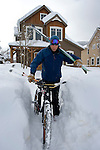 Benn Dunn at his Crested Butte home. He tries to get in at least one outdoor activity per day. In the winter, it's either downhill, cross country, or back country skiing - all of which he can access within minutes from his home office. Here, he takes a short bike ride to the shuttle that gets him to the ski mountain within minutes. Michael Brands for The New York Times.