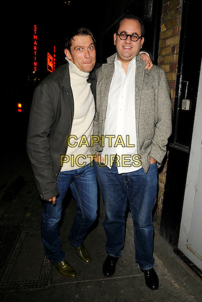 JOHN PARTRIDGE & guest .Spotted outside The Ivy restaurant, London, England, April 18th 2008..full length jeans Jon grey jacket beige cream jumper top.CAP/CAN.©Can Nguyen/Capital Pictures