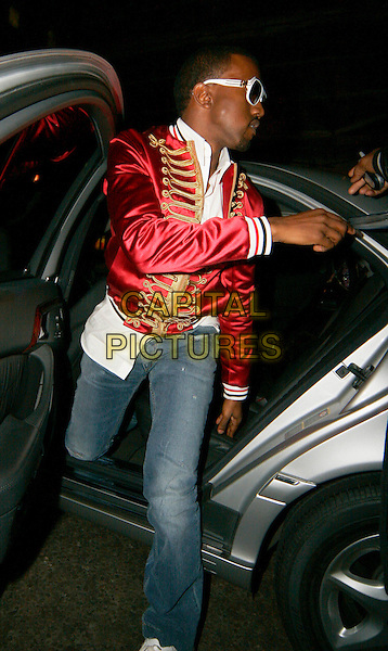 KANYE WEST.The Brit Awards aftershow party at Nobu, London, UK..February 15th, 2006.Ref: SW.Brits full length sgt pepper red military stle jacket sunglasses shades jeans denim.www.capitalpictures.com.sales@capitalpictures.com.©Capital Pictures.