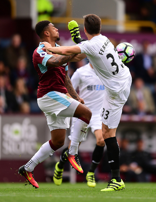 Burnley's Andre Gray vies for possession with Swansea City's Federico Fernandez<br /> <br /> Photographer Chris Vaughan/CameraSport<br /> <br /> Football - The Premier League - Burnley v Swansea City - Saturday 13th August 2016 - Turf Moor - Burnley<br /> <br /> World Copyright &copy; 2016 CameraSport. All rights reserved. 43 Linden Ave. Countesthorpe. Leicester. England. LE8 5PG - Tel: +44 (0) 116 277 4147 - admin@camerasport.com - www.camerasport.com