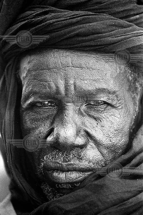 © Ami Vitale / Panos Pictures..A Mauritanian poses for a portrait  in the village of Bounessa in the Affole region of Mauritania. Bounessa is a village of only 61 families, all of one sub-clan and tribe, the Swaqer of the Hel Sidi Mahmoud. The families were once nomadic,  but since they built a dam in 1960, they are settled now. The great majority of Mauritanians use Hasaniya Arabic, which, along with Wolof, is an official language.   The country has a complex social caste system, with light-skinned Moors usually in positions of power and black Africans often at the bottom of the social ladder.  (Photo by Ami Vitale)