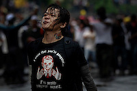 "A supporter of the ""Bersih"" electoral reform coalition spits towards police during clashes in downtown Kuala Lumpur July 9, 2011. Malaysian police fired tear gas and detained more than 500 people in the capital on Saturday in a bid to prevent thousands of anti-government protesters from putting on a massive show of strength against Prime Minister Najib Razak.  REUTERS/Damir Sagolj (MALAYSIA)"