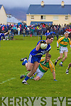 St Mary's Brian Sheehan breaks away from the tackle of Skellig Rangers man Stephen O'Sullivan.