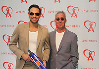 Eric Villency and Ted Sann attend The Let's Misbehave Party to Benefit Love Heals on July 19, 2014 (Photo By Taylor Donohue/Guest Of A Guest)