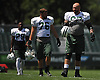 Brian Winters #67 of the New York Jets, right, stretches alongside #76 Wesley Johnson, center, and #29 Bilal Powell at the start of a day of team training camp at Atlantic Health Jets Training Center in Florham Park, NJ on Thursday, Aug. 4, 2016.