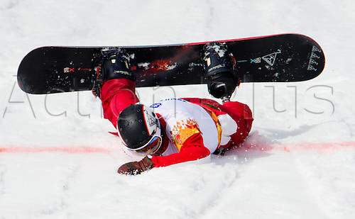 14.03.2014. Sochi, Russia.  Alexander Ilinov of Russia pushes himself to the finish line during the Men's Para-Snowboard in Rosa Khutor Alpine Center at the Sochi 2014 Paralympic Winter Games, Krasnaya Polyana, Russia, 14 March 2014.