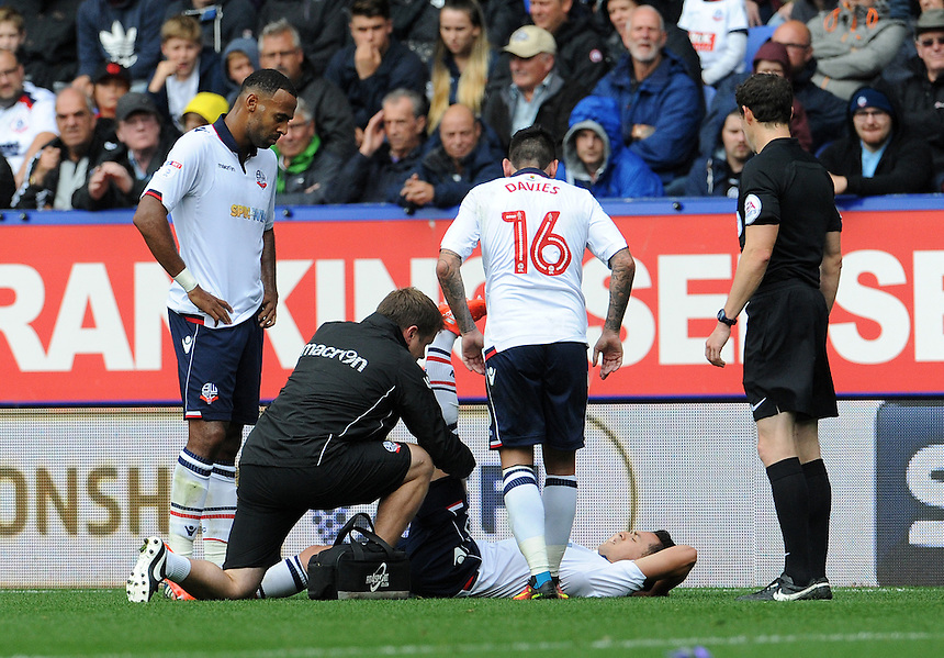 Bolton Wanderers's Zach Clough is treated by the medics and ends up going off injured <br /> <br /> Photographer Ian Cook/CameraSport<br /> <br /> Football - The EFL Sky Bet League One - Bolton Wanderers v Fleetwood Town - Saturday 20 August 2016 - Macron Stadium - Bolton<br /> <br /> World Copyright &copy; 2016 CameraSport. All rights reserved. 43 Linden Ave. Countesthorpe. Leicester. England. LE8 5PG - Tel: +44 (0) 116 277 4147 - admin@camerasport.com - www.camerasport.com
