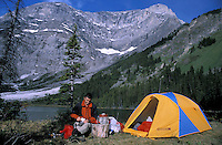 CANADA, ALBERTA, KANANASKIS, MAY 2002.  A camper cooks at Evan Thomas lake. The Kananaskis Country provincial park is home to Canada's most beautiful nature and wildlife. It has also escaped the mass tourism as in Banff National Park. Photo by Frits Meyst/Adventure4ever.com