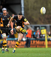 High Wycombe, England. Stephen Jones of London Wasps kicks for positionduring the Aviva Premiership match between London Wasps and Sale Sharks at Adams Park on December 23. 2012 in High Wycombe, England.