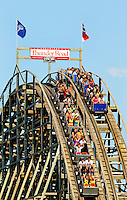 Carowinds, a Cedar Fair Entertainment Company amusement / theme park, is home to Thunder Road, a 58-mph wooden racing roller coaster that runs across the North Carolina/South Carolina state line. Thunder Road twin train coaster was built in 1976 by the Philadelphia Toboggan Company. Carowinds is a 122-acre theme park / entertainment / amusement park located on the state line between North and South Carolina near Charlotte, NC.
