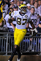 12 October 2013:  Michigan TE Devin Funchess (87) celebrates after his second long touchdown catch of the game. The Penn State Nittany Lions defeated the Michigan Wolverines 43-40 in 4OTs at Beaver Stadium in State College, PA.
