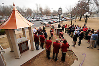 NWA Media/ J. T. WAMPLER- Guests gather for the dedication the Springdale Public Schools Education Foundation's new monument outside the school district administration building Friday Dec. 12, 2014. The monument features the names of Springdale Public Schools Education Foundation donors.