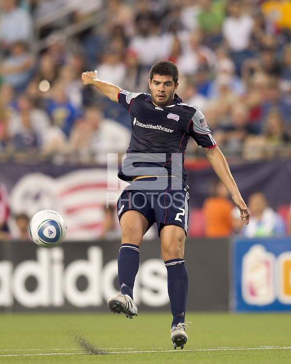 New England Revolution defender Franco Coria (2) clears the ball. In a Major League Soccer (MLS) match, the New England Revolution tied the Chicago Fire, 1-1, at Gillette Stadium on June 18, 2011.