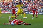Gino Padila Columbus Crew leaps over Daniel Woolard Chicago Fire