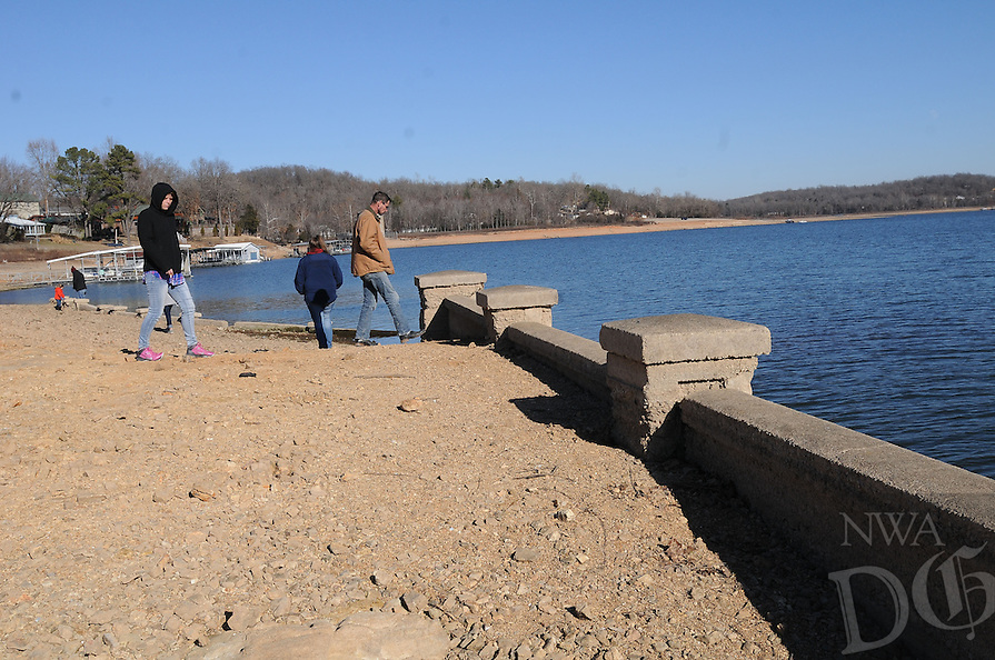 NWA Democrat-Gazette/FLIP PUTTHOFF <br /> Visitors see the remnants of the Monte Ne amphitheater on Jan. 7 2017. The amphitheater, part of the historic Monte Ne resort, appear when the lake level is low. The resort, built by Coin Harvey, operated in the early 20th century.