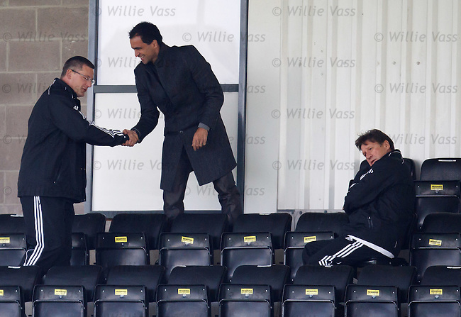 Craig Levein greets Wigan manager Roberto Martinez at training as Mick Oliver looks away