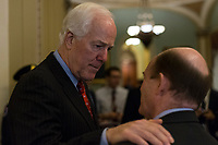 United States Senate Majority Whip John Cornyn (Republican of Texas) speaks with US Senator Chris Coons (Democrat of Delaware) outside the US Senate chamber in the US Capitol in Washington, DC on Friday, December 1, 2017.  <br /> Credit: Alex Edelman / CNP /MediaPunch