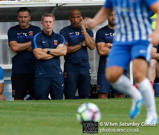 Hartlepool United 0 Sunderland 3, 20/07/2016. Victoria Park, Pre Season Friendly. Craig Hignett Manager of Hartlepool United, Curtis Fleming First Team Coach, and Tony Caig ,Goalkeeping Coach, watch the game. Photo by Paul Thompson.
