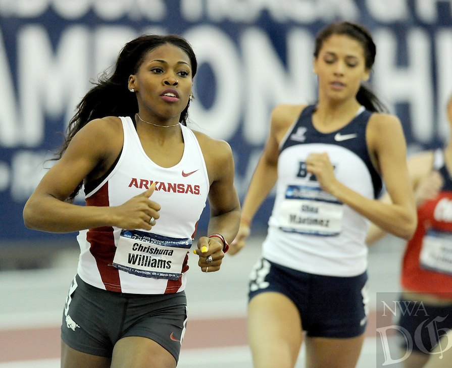 NWA Democrat-Gazette/ANDY SHUPE - Chrishuna Williams (left) of Arkansas leads Shea Martinez of BYU in the 800 meters Saturday, March 14, 2015, in the NCAA Indoor Track and Field Championship at the Randal Tyson Track Center in Fayetteville.