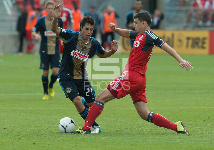 15 September 2012: Philadelphia Union midfielder Michael Farfan #21 and Toronto FC defender Darren O'Dea #48 in action during an MLS game between the Philadelphia Union and Toronto FC at BMO Field in Toronto, Ontario Canada. .The game ended in a 1-1 draw.