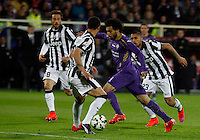 Calcio, Coppa Italia: semifinale di ritorno Fiorentina vs Juventus. Firenze, stadio Artemio Franchi, 7 aprile 2015. <br /> Fiorentina's Mohamed Salah, second from right, is challenged, from left, by Juventus' Claudio Marchisio, Stefano Sturaro and Juventus' Arturo Vidal, right, during the Italian Cup semifinal second leg football match between Fiorentina and Juventus at Florence's Artemio Franchi stadium, 7 April 2015.<br /> UPDATE IMAGES PRESS/Isabella Bonotto