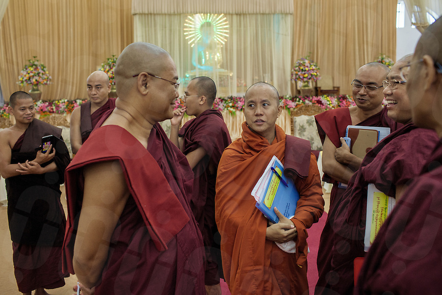 Ashin Wirathu (centre) and Wimalar Biwuntha (far left) – another of the prominent member of 969 movement - are amongst more than 200 Myanmar Buddhist monks gathered to discuss how to solve inter-religious conflicts between Buddhists and Muslims. The conference, held in a monastery on the outskirts of Yangon was dubbed by local and international media less as a resolution to conflict but more as an opportunity to discuss the inter-faith marriage law that the 969 movement is hoping to present to the government. 14 June 2013 © Thomas Cristofoletti / Ruom