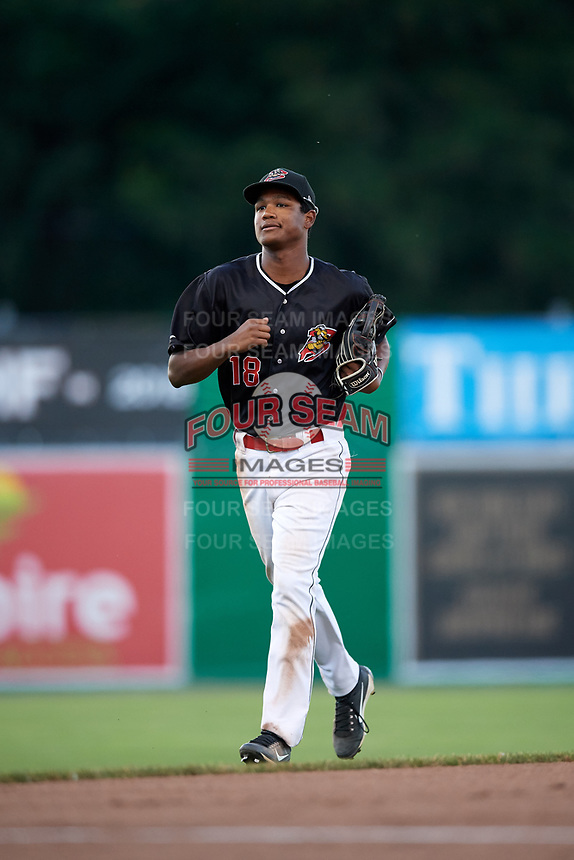 Batavia Muckdogs center fielder Brayan Hernandez (18) jogs to the dugout during a game against the State College Spikes on July 7, 2018 at Dwyer Stadium in Batavia, New York.  State College defeated Batavia 7-4.  (Mike Janes/Four Seam Images)