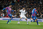 Real Madrid´s Karim Benzema (C) and Levante´s Navarro (L) and Ramis during La Liga match at Santiago Bernabeu stadium in Madrid, Spain. March 15, 2015. (ALTERPHOTOS/Victor Blanco)