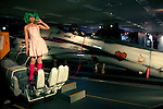 Macross, May 1st 2012, Tokyo, Japan -  Japanese girl dressed as a Ranka Lee on Life-size Macross Valkyrie. Macross was a popular science fiction animation series that started in 1982. The 30th Anniversary of Macross exposition was held at Sunshine City in the Ikebukuro Ward of Tokyo.
