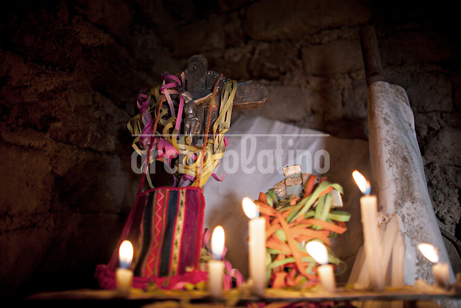 """A picture dated Friday January 25, 2013 shows an image of Christ in the Cross or """"Tata Ckaccha"""" before the Miners Carnival in the Andes city of Potosi in Bolivia.Already in 1663 the Spanish chronicler Marquez Jerez de los Caballeros described the colorful  miners carnival in Potosi. Four centuries later, the tradition of the legendary Cerro Rico miners is  still alive .."""