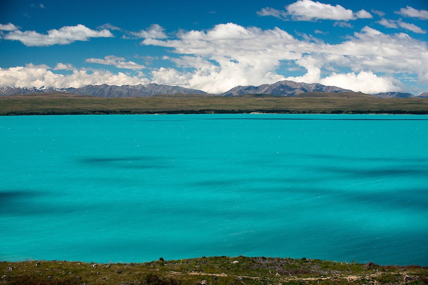Clouds dance over Lake Pukaki in Mount Cook National Park on the South Island of New Zealand.