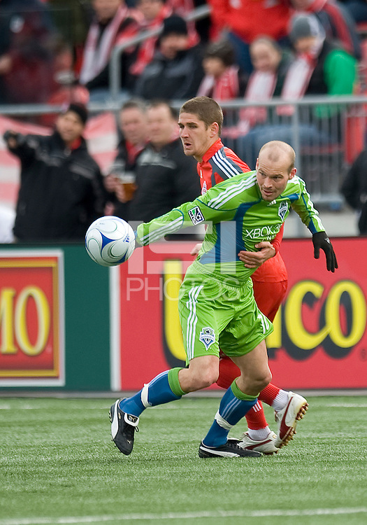 Freddie Ljungberg (10) of the Seattle Sounders FC and Carl Robinson (33) of Toronto FC in MLS action at BMO Field on April 4, 2009.Seattle won 2-0.