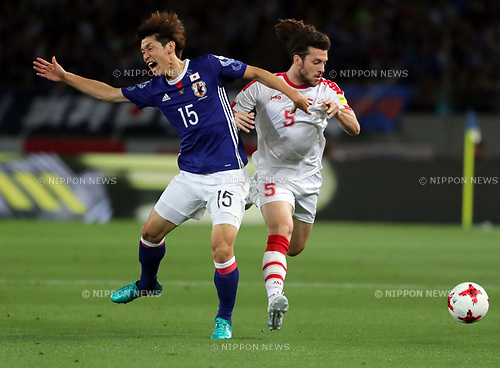 June 7, 2017, Tokyo, Japan - Japan's Yuya Osako (L) fights the ball Syria's Omro Al Midani during a friendly match between Japan and Syria Kirin Challenge Cup in Tokyo on Wednesday, June 7, 2017. Japan and Syria drew the game 1-1.  (Photo by Yoshio Tsunoda/AFLO) LwX -ytd-