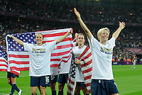 London, England - Thursday, August 9, 2012: The USA defeated Japan 2-1 to win the London 2012 Olympic gold medal at Wembley Arena. Megan Rapinoe celebrates, right, with Heather O'Reilly center, and Rachel Buehler, left.